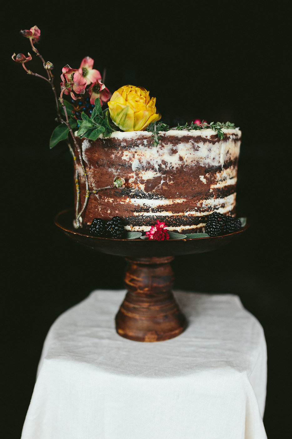naked wedding cakes - photo by Hannah Victoria Photography http://ruffledblog.com/rich-toned-industrial-wedding-inspiration