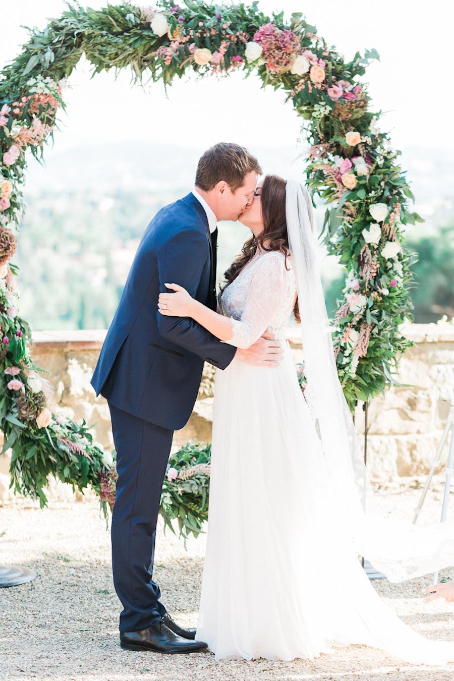 ceremony kiss - photo by Kylee Yee https://ruffledblog.com/romantic-al-fresco-wedding-in-tuscany