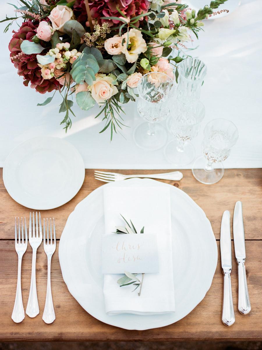 place settings - photo by Kylee Yee http://ruffledblog.com/romantic-al-fresco-wedding-in-tuscany