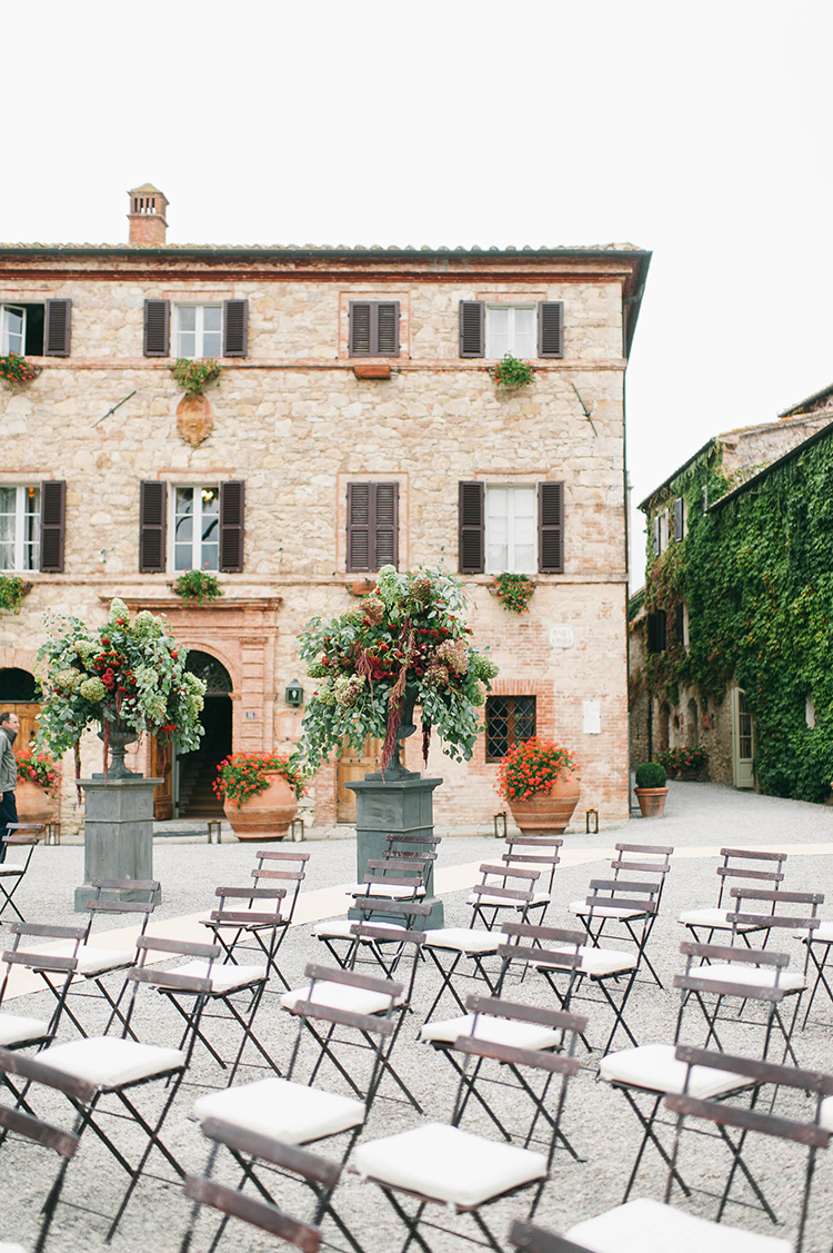 wedding ceremony seating - photo by Lisa Poggi https://ruffledblog.com/romantic-black-tie-wedding-in-tuscany
