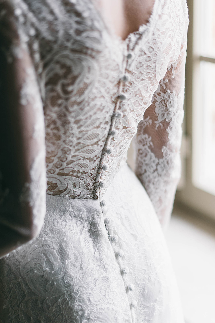 long sleeve lace wedding dresses - photo by Lisa Poggi http://ruffledblog.com/romantic-black-tie-wedding-in-tuscany