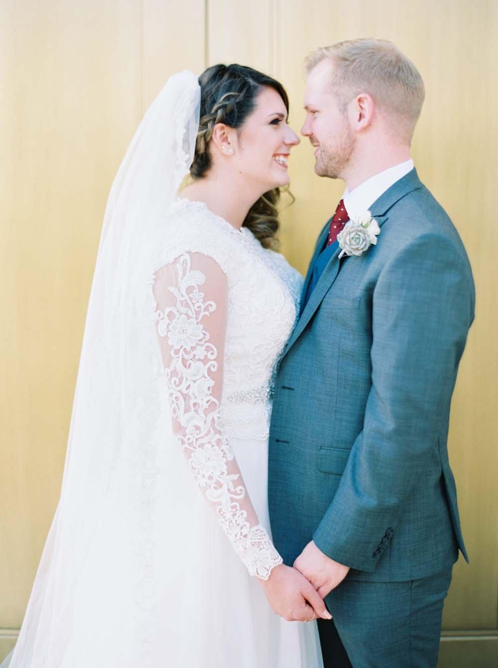 modest sleeved wedding dresses - photo Melissa Jill https://ruffledblog.com/romantic-blush-and-burgundy-phoenix-wedding