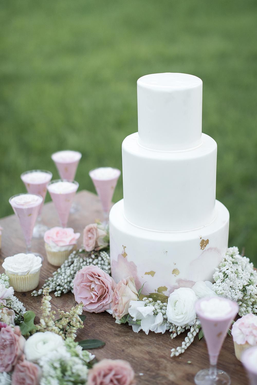 white wedding cakes - photo by Tyler Rye Photography https://ruffledblog.com/romantic-coastal-california-wedding-inspiration