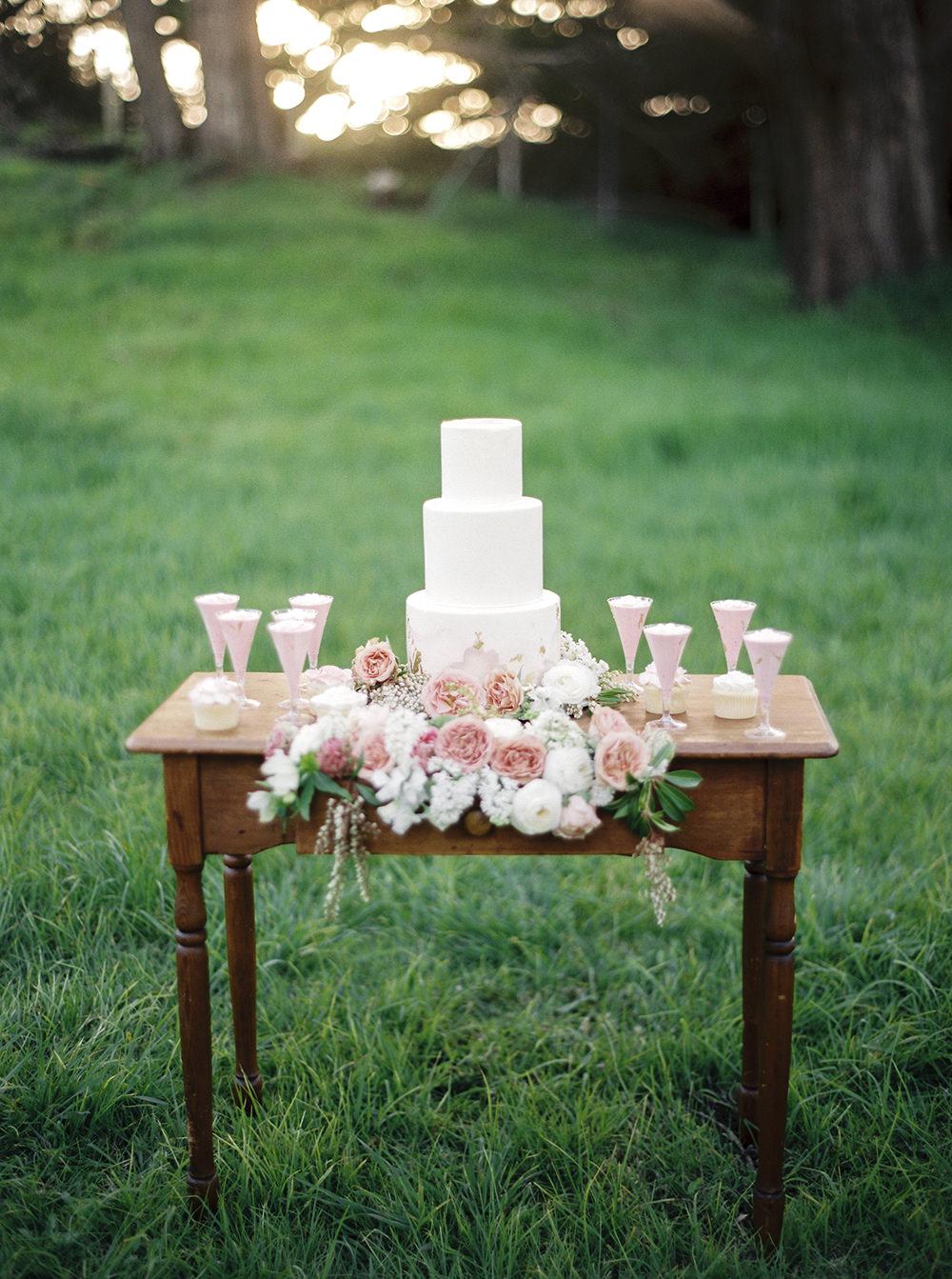 cake tables - photo by Tyler Rye Photography https://ruffledblog.com/romantic-coastal-california-wedding-inspiration