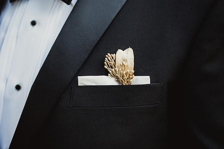 groom boutonnieres - photo by Shaun Menary Photography https://ruffledblog.com/romantic-garden-wedding-at-arlington-hall