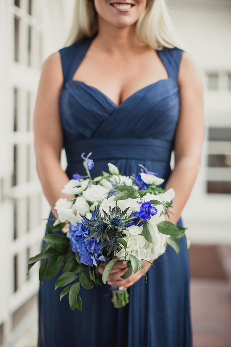bridesmaids in blue - photo by Shaun Menary Photography https://ruffledblog.com/romantic-garden-wedding-at-arlington-hall