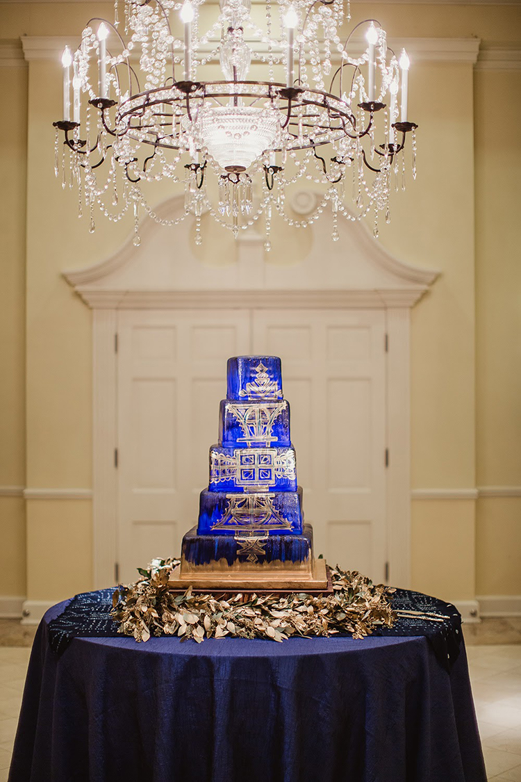 blue and gold wedding cakes - photo by Shaun Menary Photography https://ruffledblog.com/romantic-garden-wedding-at-arlington-hall