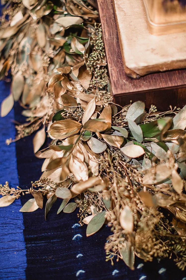 gold leaves - photo by Shaun Menary Photography https://ruffledblog.com/romantic-garden-wedding-at-arlington-hall