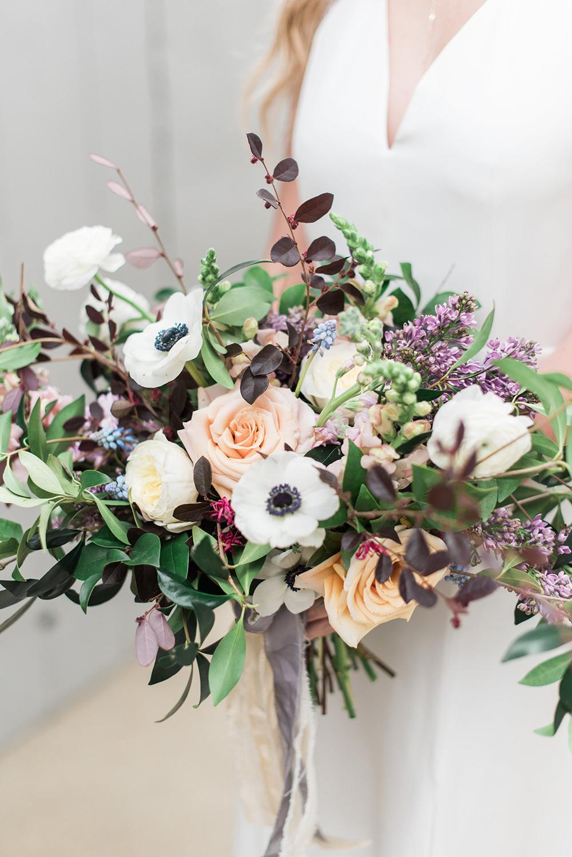 wedding bouquet with anemones - photo by Holly Von Lanken Photography https://ruffledblog.com/romantic-modern-minimalist-wedding-inspiration