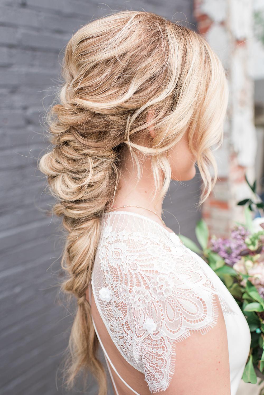braided wedding hair - photo by Holly Von Lanken Photography https://ruffledblog.com/romantic-modern-minimalist-wedding-inspiration