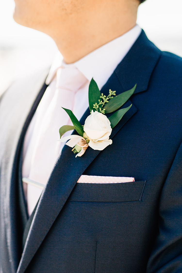 romantic soft peach wedding boutonnieres - https://ruffledblog.com/romantic-pacific-northwest-wedding-with-mauve-and-champagne