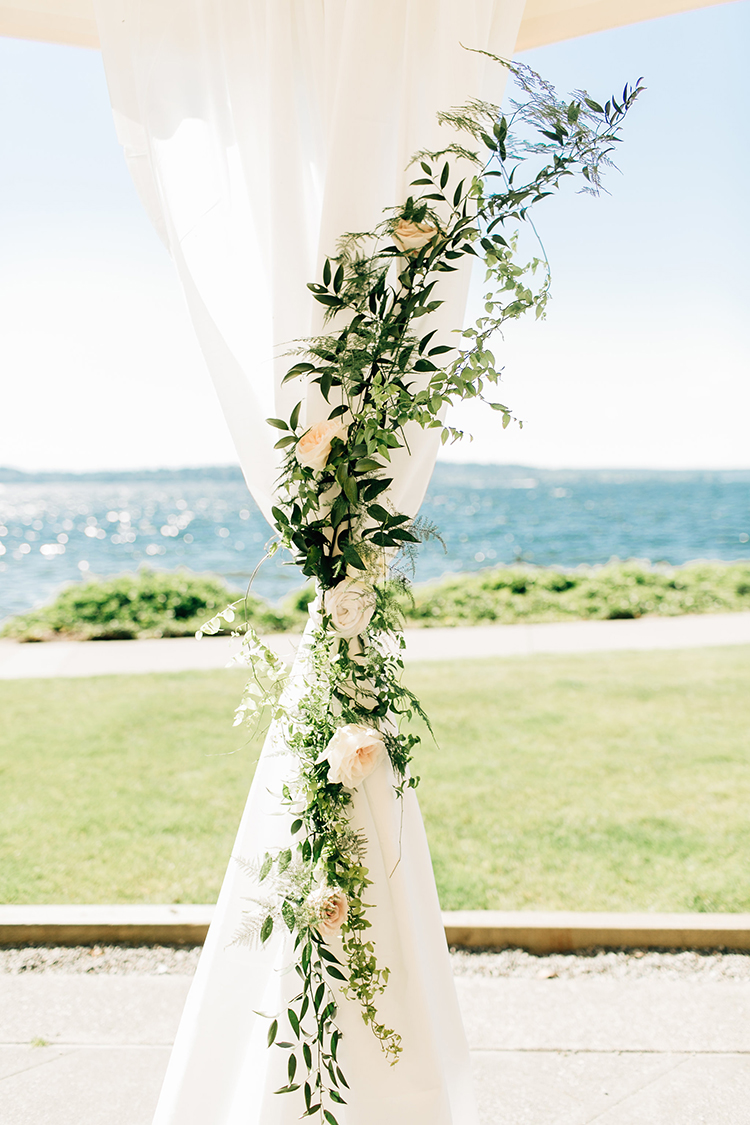 floral wedding ceremony accents - http://ruffledblog.com/romantic-pacific-northwest-wedding-with-mauve-and-champagne