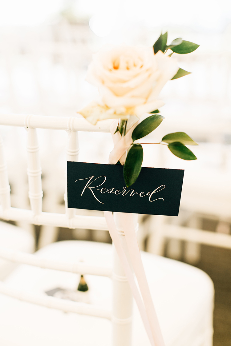 reserved wedding chair signs - https://ruffledblog.com/romantic-pacific-northwest-wedding-with-mauve-and-champagne