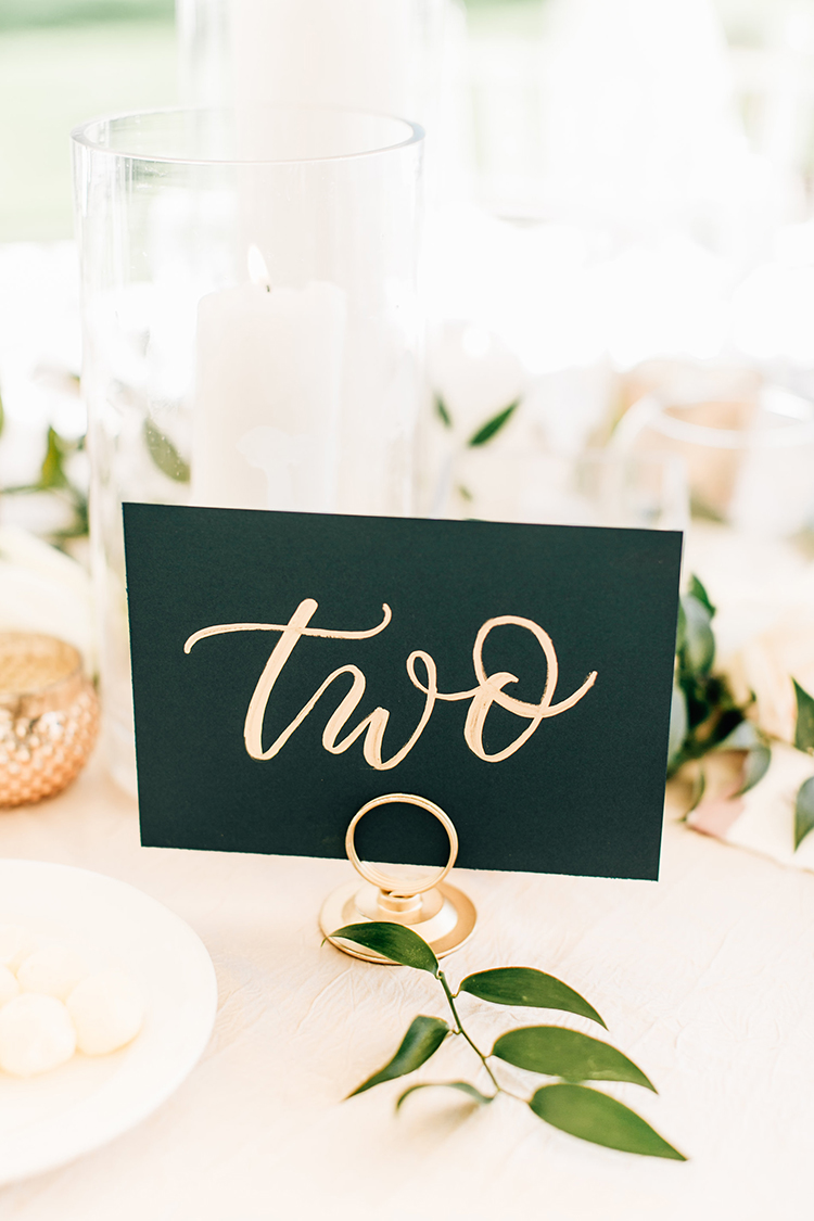 calligraphy table numbers - https://ruffledblog.com/romantic-pacific-northwest-wedding-with-mauve-and-champagne