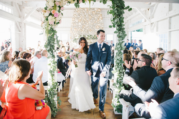 ceremony recessional - photo by Michelle Gardella Photography https://ruffledblog.com/romantic-seaside-wedding