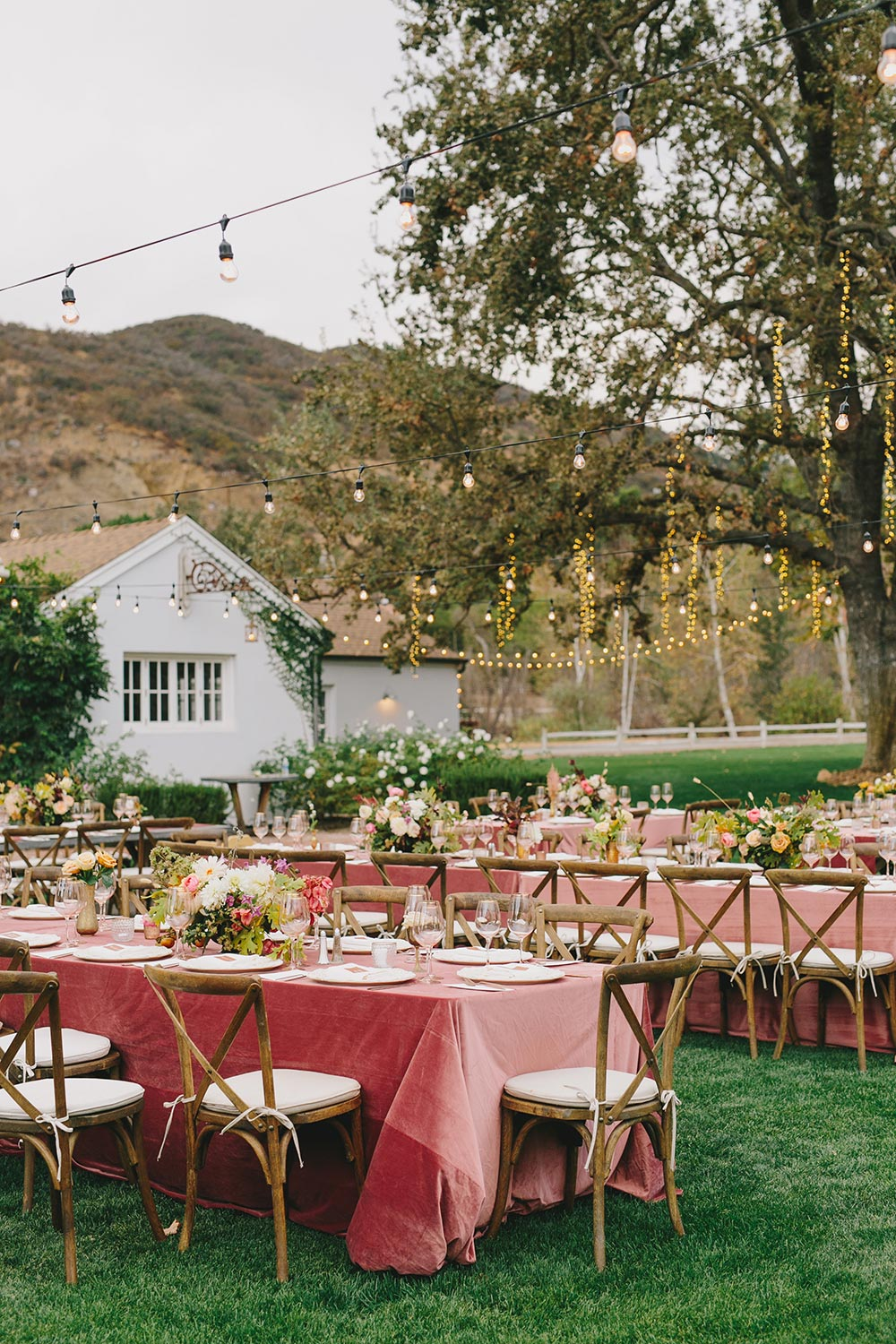 pink wedding tablescapes with market lights vineyard wedding
