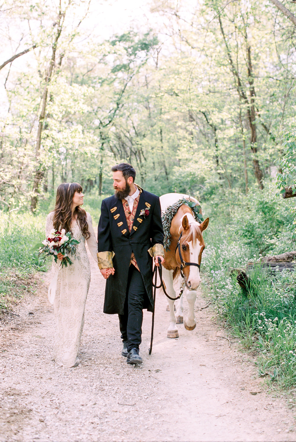 horses at weddings - photo by Laura Ann Miller Photography https://ruffledblog.com/royalty-inspired-wedding-ideas-at-a-castle