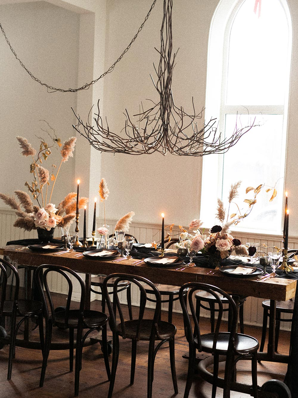pampas grass tablescape with thin branch chandelier