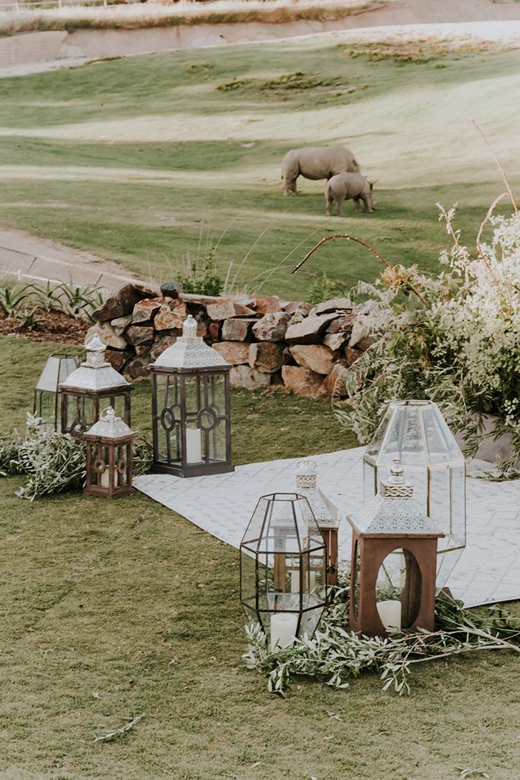 boho eclectic wedding ceremony decor - photo by Shelly Anderson Photography https://ruffledblog.com/san-diego-safari-park-glamping-wedding-editorial