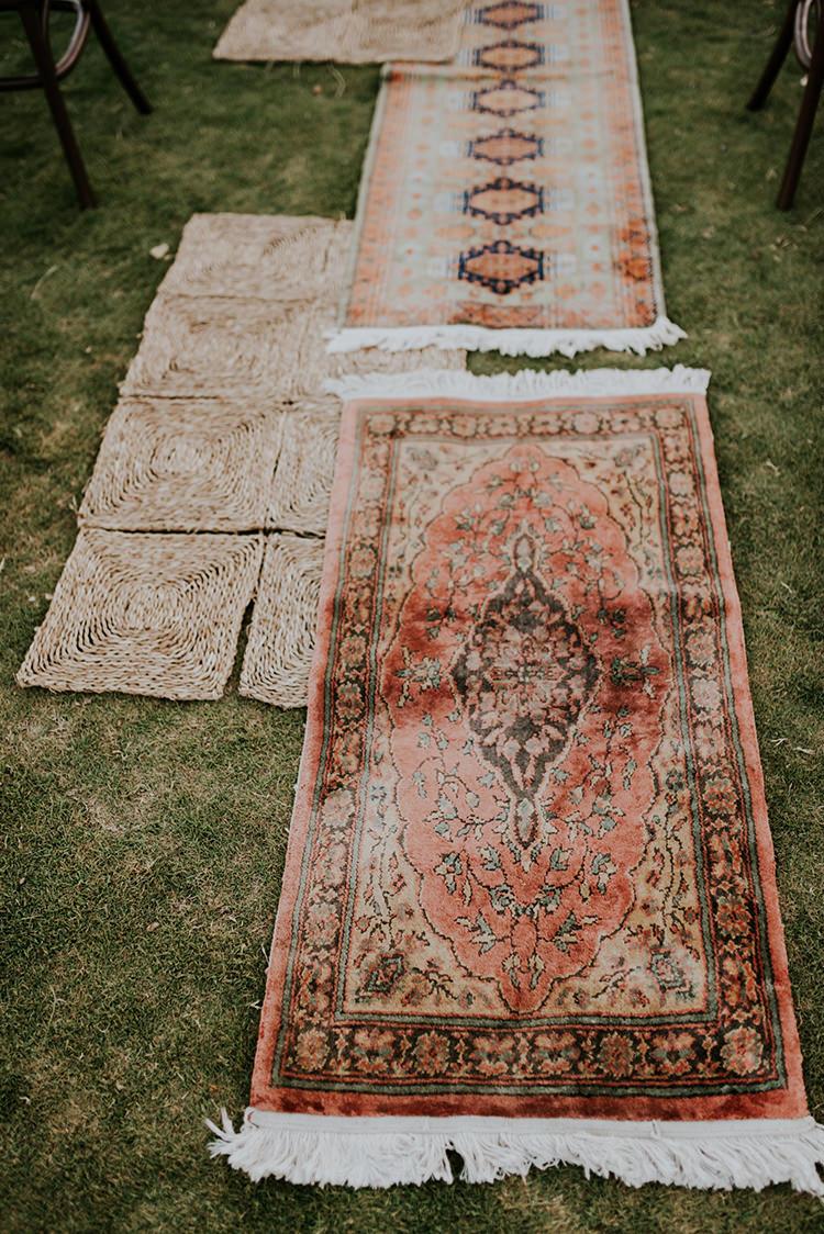 vintage rug ceremonies - photo by Shelly Anderson Photography https://ruffledblog.com/san-diego-safari-park-glamping-wedding-editorial