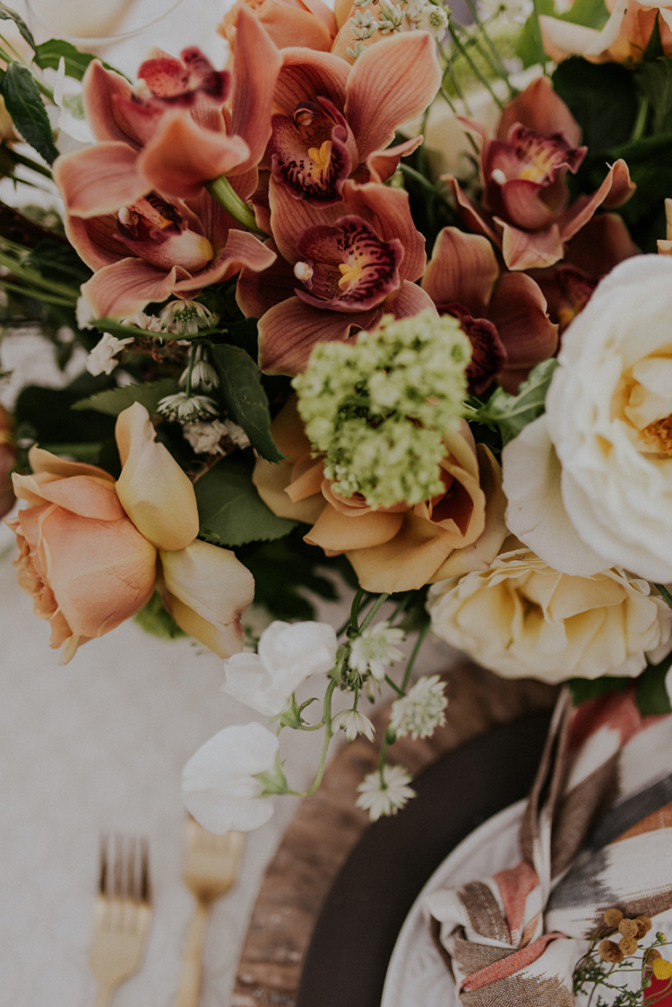 wedding floral arrangements - photo by Shelly Anderson Photography https://ruffledblog.com/san-diego-safari-park-glamping-wedding-editorial