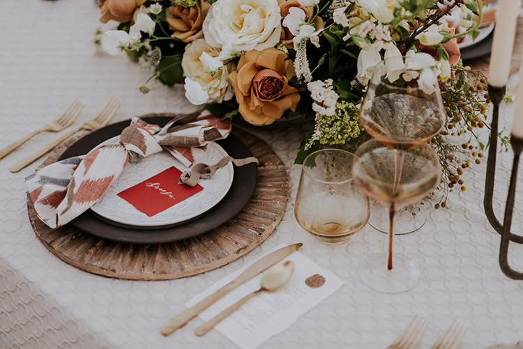 wedding tables with red paper goods - photo by Shelly Anderson Photography http://ruffledblog.com/san-diego-safari-park-glamping-wedding-editorial