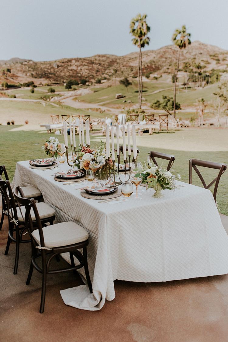 outdoor wedding reception tables - photo by Shelly Anderson Photography https://ruffledblog.com/san-diego-safari-park-glamping-wedding-editorial
