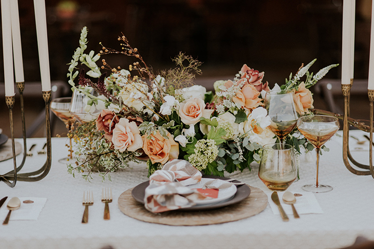 romantic wedding centerpieces - photo by Shelly Anderson Photography http://ruffledblog.com/san-diego-safari-park-glamping-wedding-editorial