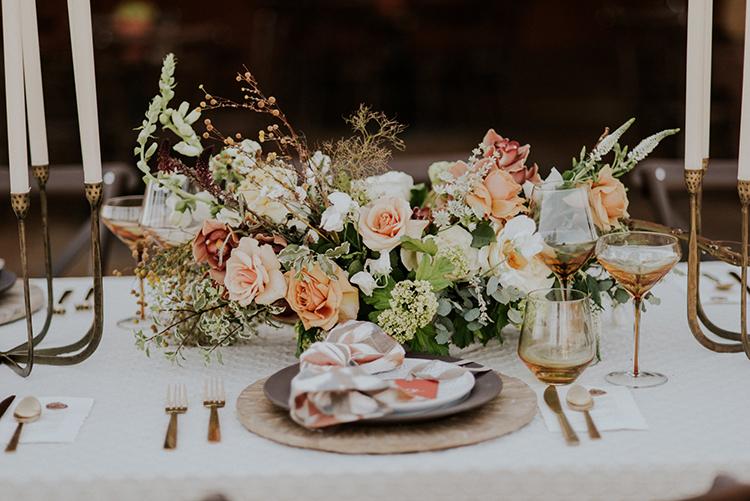 romantic wedding centerpieces - photo by Shelly Anderson Photography https://ruffledblog.com/san-diego-safari-park-glamping-wedding-editorial