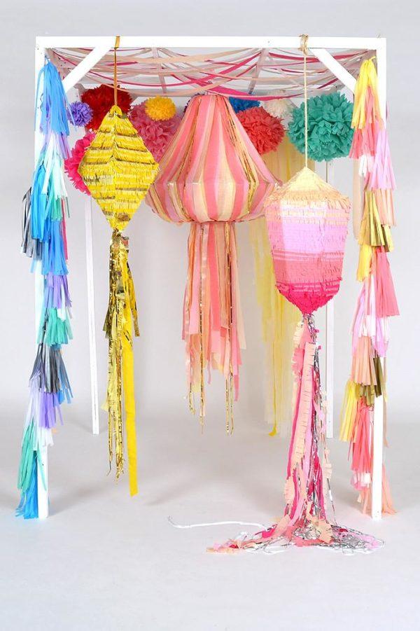 geometric paper chandeliers and pinatas by Scene Setter https://ruffledblog.com/40-eye-catching-geometric-wedding-ideas