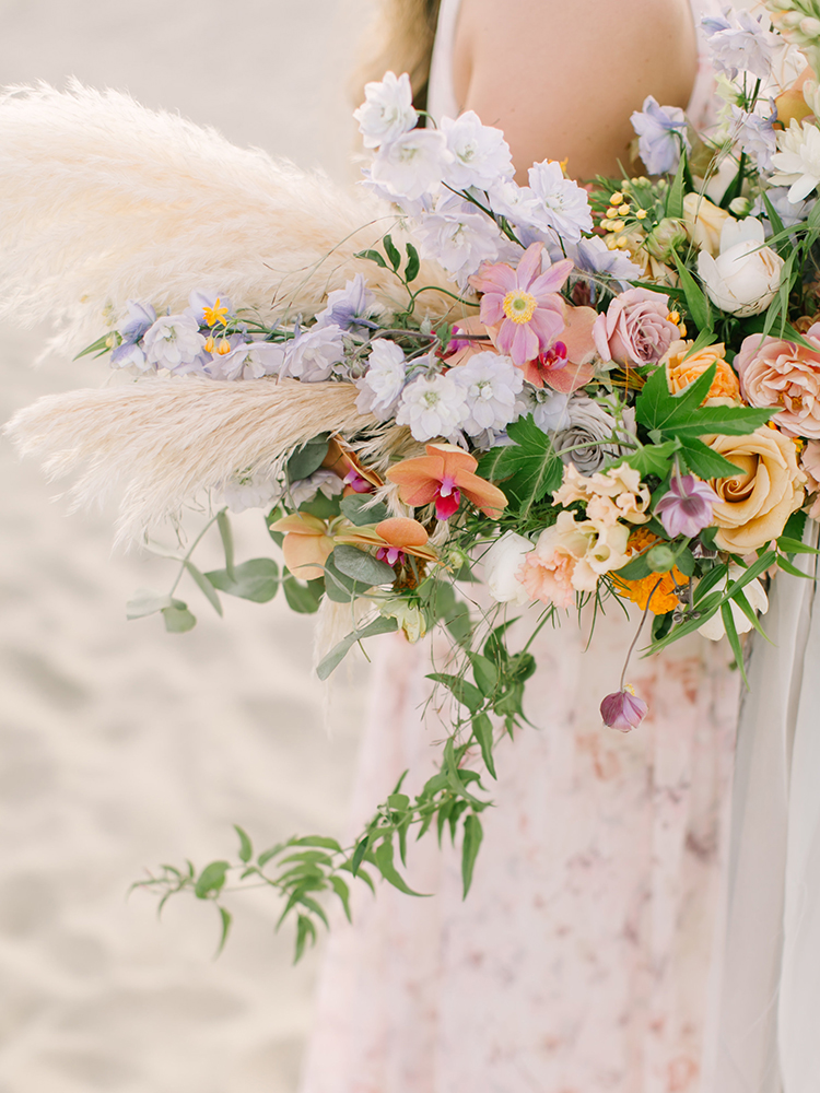 eclectic floral arrangements - https://ruffledblog.com/september-sunsets-wedding-inspiration-with-a-vw-bus