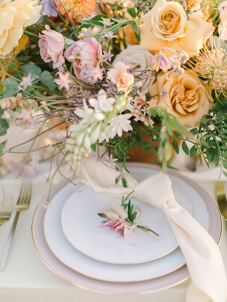 romantic place settings with dusty yellow - https://ruffledblog.com/september-sunsets-wedding-inspiration-with-a-vw-bus
