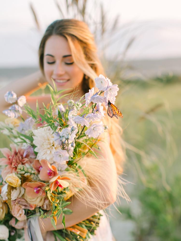 butterflies at weddings - http://ruffledblog.com/september-sunsets-wedding-inspiration-with-a-vw-bus
