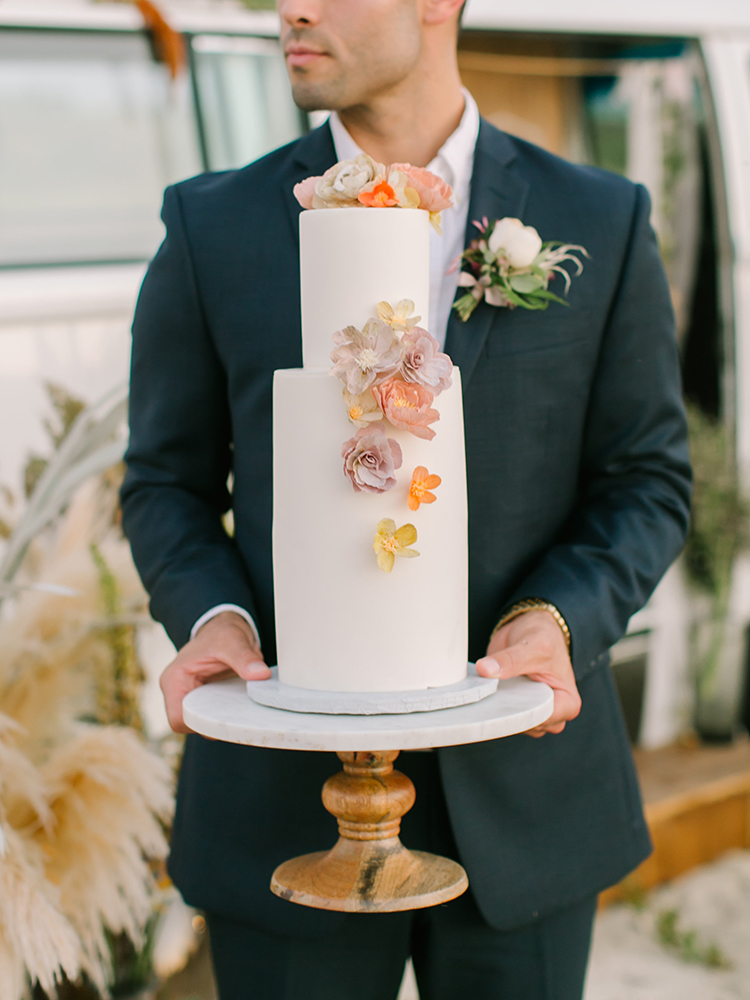 wedding cakes with crepe flowers - http://ruffledblog.com/september-sunsets-wedding-inspiration-with-a-vw-bus