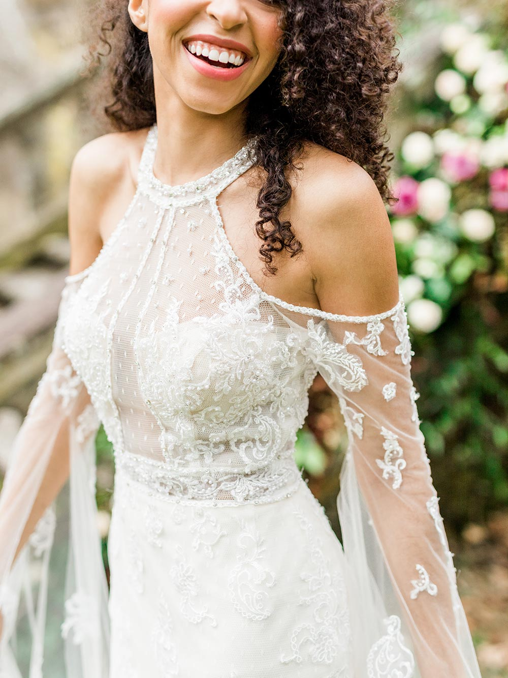 ethereal flowy bell sleeve wedding dress with cold shoulder detail