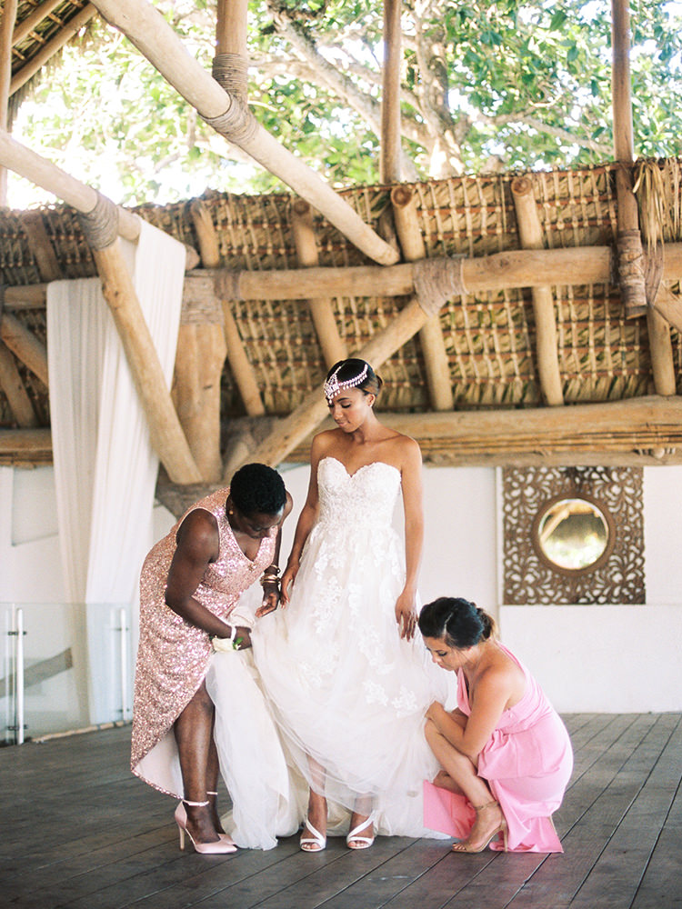 bride getting ready - photo by Asia Pimentel Photography https://ruffledblog.com/seriously-chic-destination-wedding-in-punta-cana