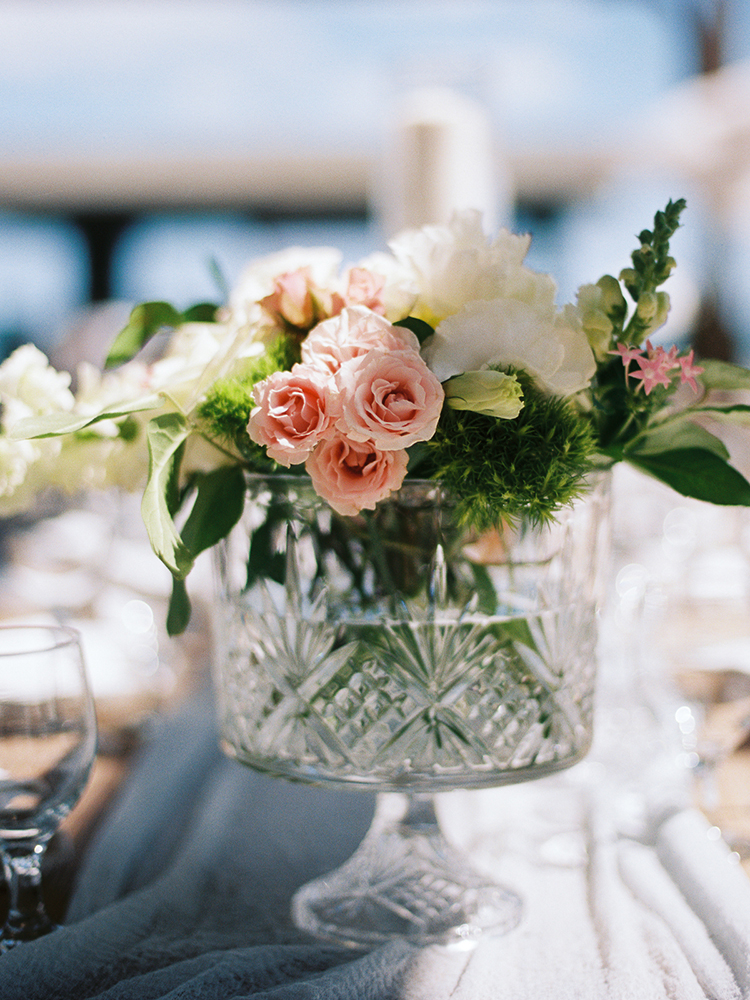 unique vase centerpieces - photo by Asia Pimentel Photography http://ruffledblog.com/seriously-chic-destination-wedding-in-punta-cana