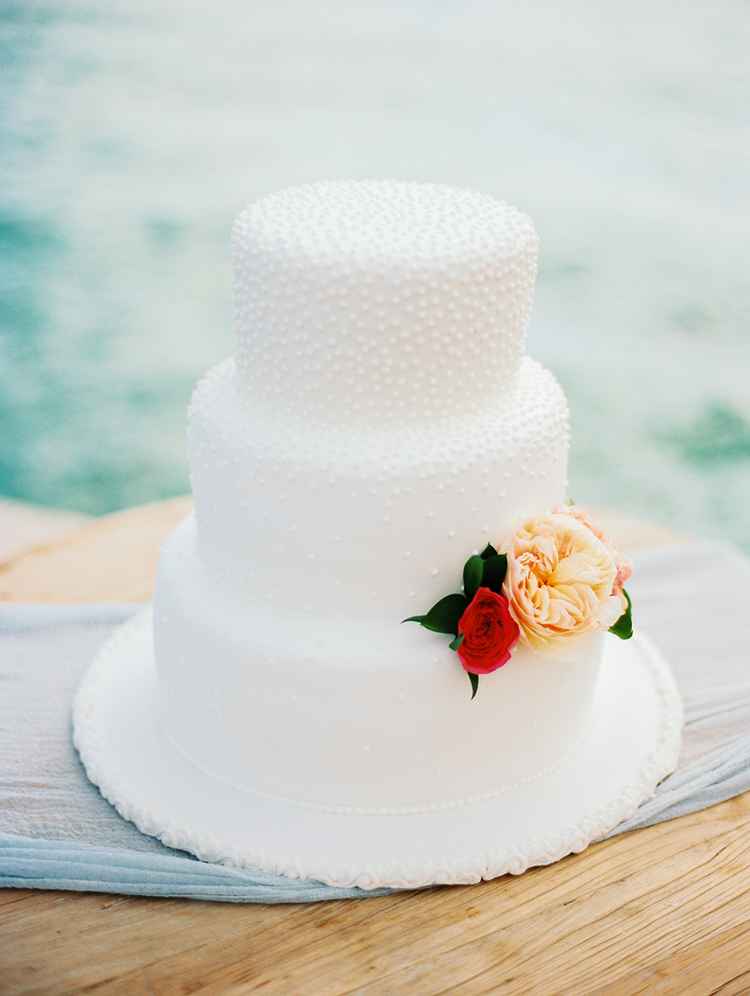 all white wedding cakes with flowers - photo by Asia Pimentel Photography https://ruffledblog.com/seriously-chic-destination-wedding-in-punta-cana
