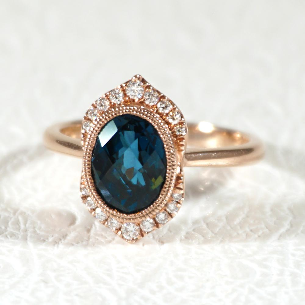 blue topaz engagement ring with migraine beading