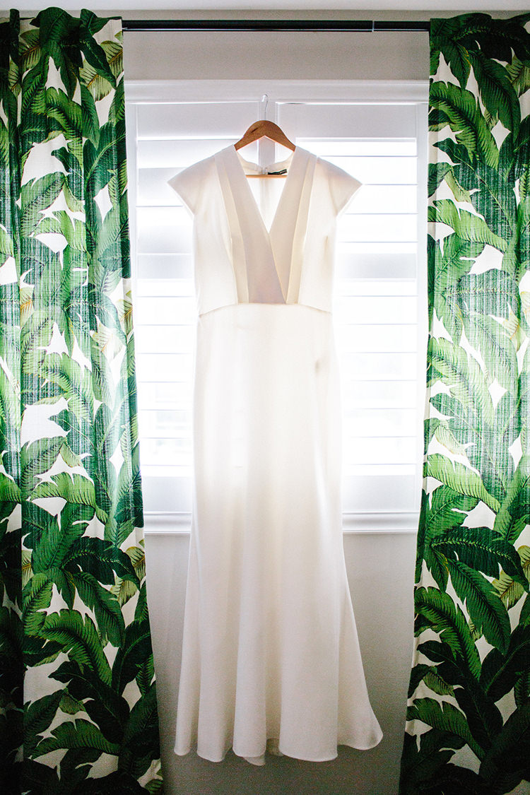 modern v-neck wedding dresses - photo by Birds of a Feather http://ruffledblog.com/soft-and-romantic-wedding-at-lombardi-house