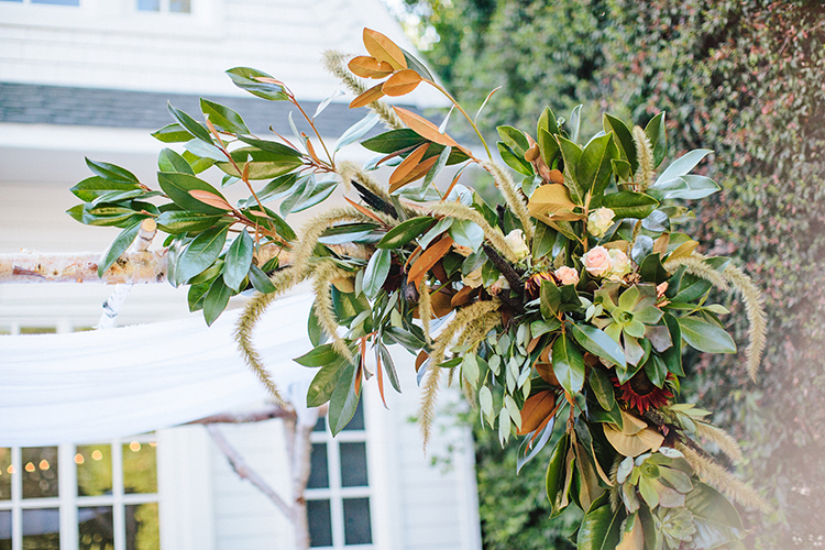 magnolia leaf ceremony arches - photo by Birds of a Feather http://ruffledblog.com/soft-and-romantic-wedding-at-lombardi-house