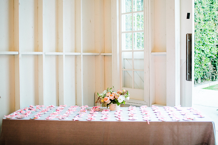 simple seating chart display - photo by Birds of a Feather https://ruffledblog.com/soft-and-romantic-wedding-at-lombardi-house