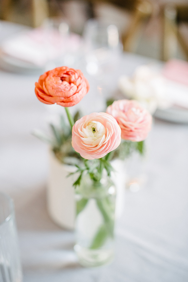 ranunculus bud vase centerpieces - photo by Birds of a Feather https://ruffledblog.com/soft-and-romantic-wedding-at-lombardi-house