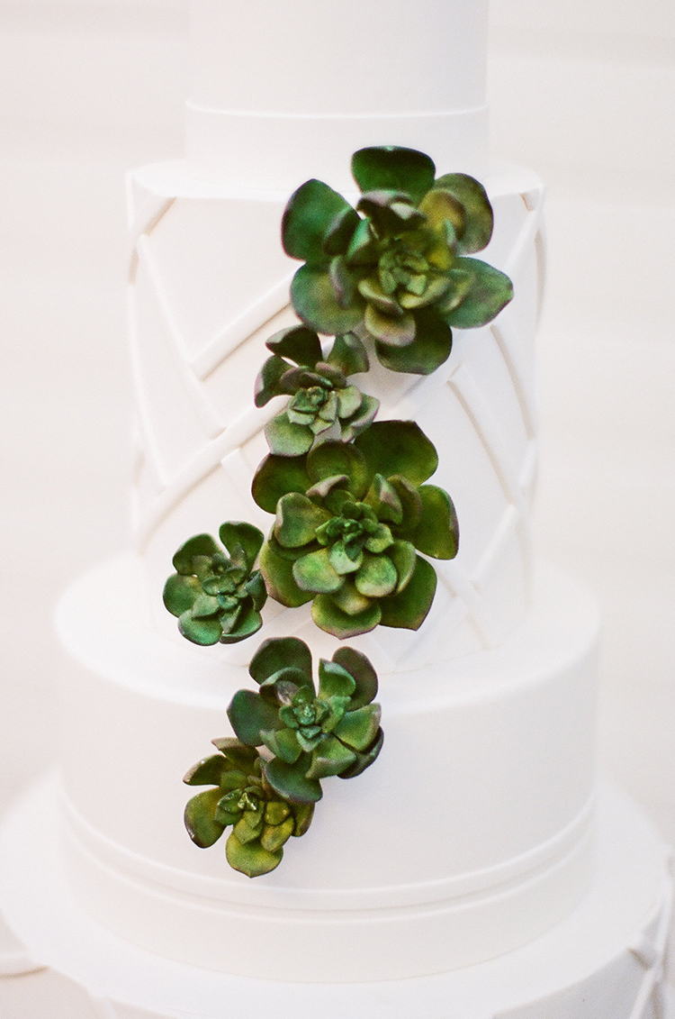 wedding cakes with geometric detail and succulents - photo by Birds of a Feather https://ruffledblog.com/soft-and-romantic-wedding-at-lombardi-house