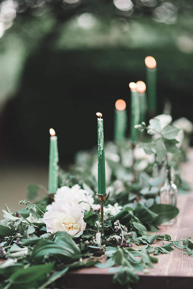 greenery table runners with green candles - https://ruffledblog.com/soft-romantic-wedding-inspiration-in-all-green