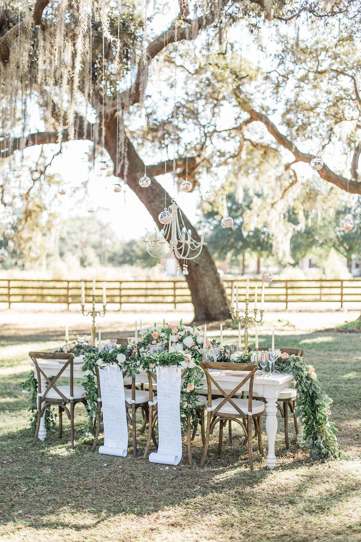romantic wedding receptions - photo by Landon Hendrick Photography https://ruffledblog.com/southern-garden-chic-wedding-inspiration