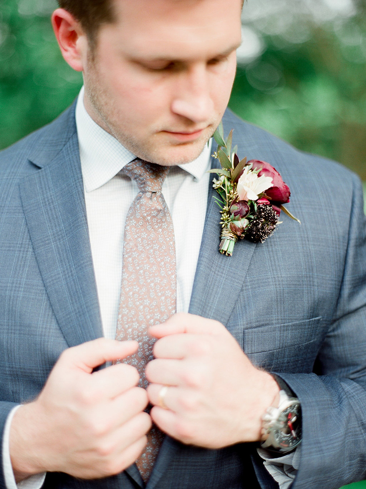 groom boutonnieres - photo by Julie Paisley http://ruffledblog.com/southern-summer-wedding-inspiration-with-berry-hues