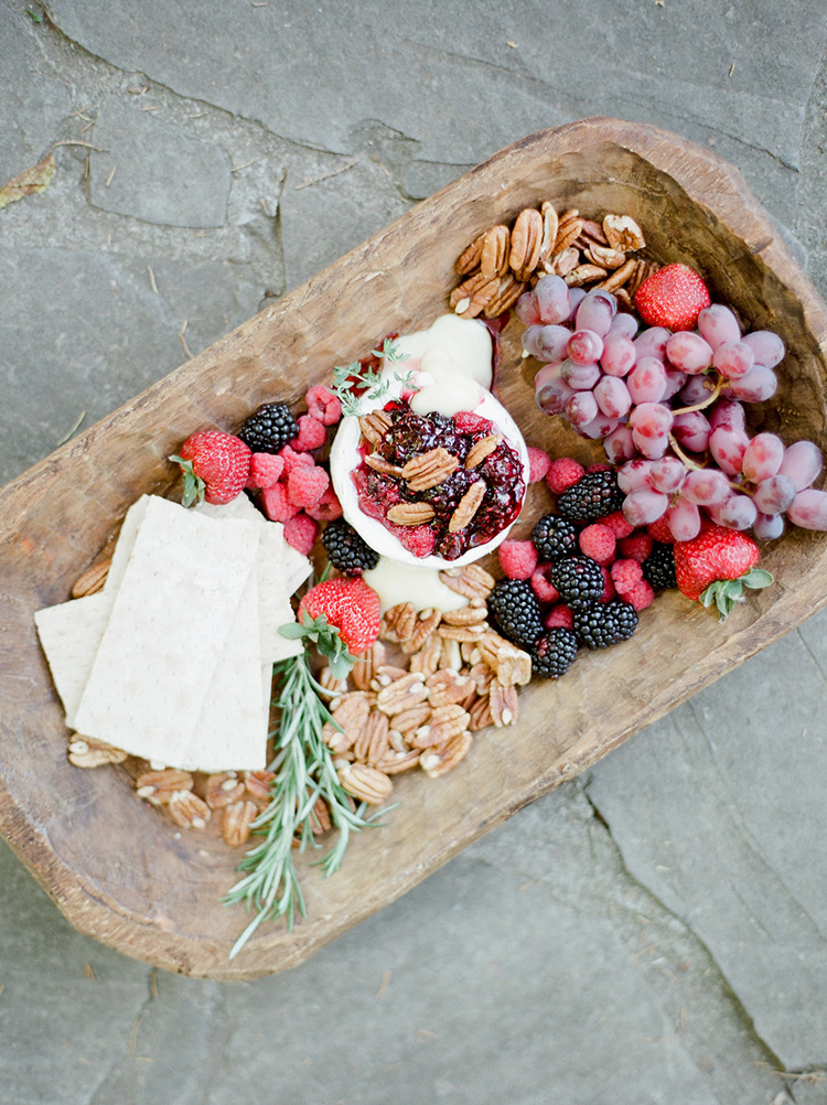 berry and cheese platter styled - photo by Julie Paisley https://ruffledblog.com/southern-summer-wedding-inspiration-with-berry-hues