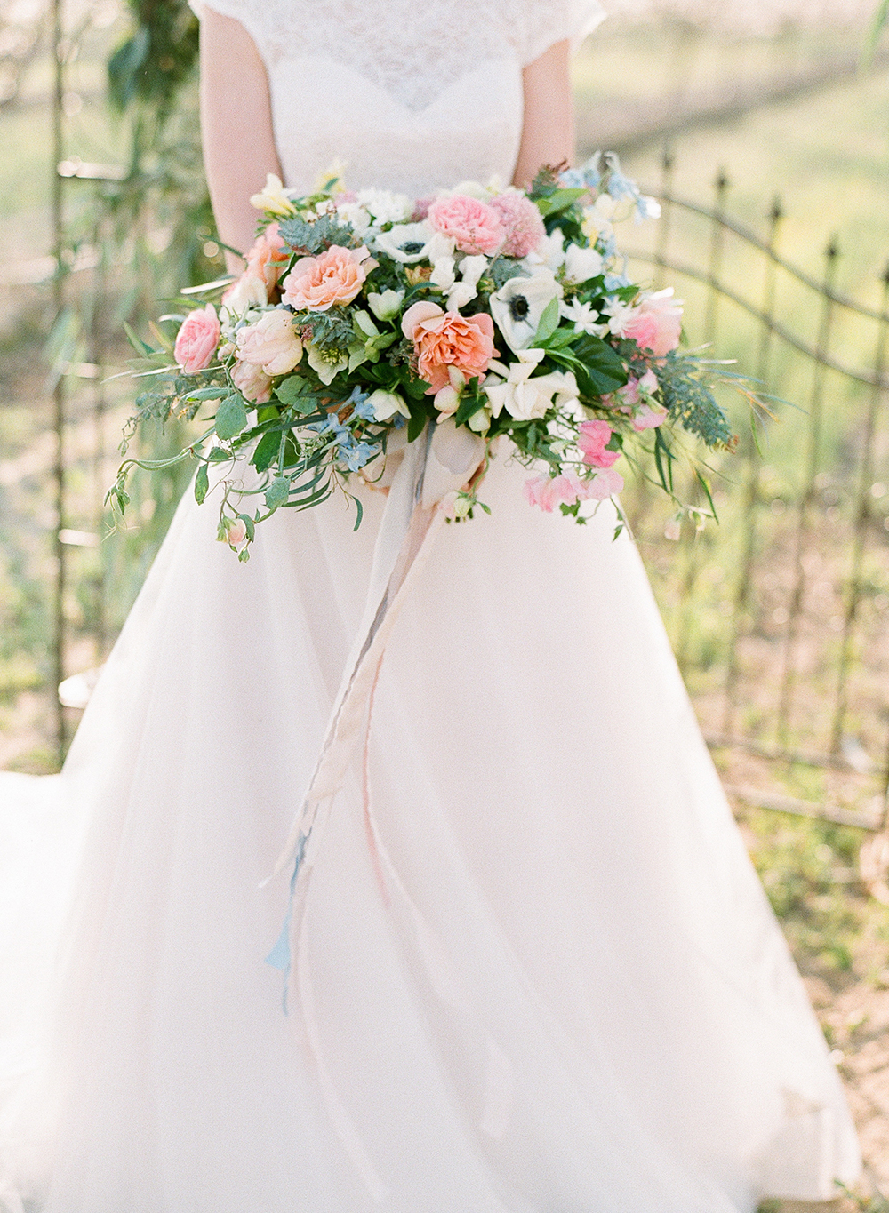 romantic wedding bouquets with anemone - photo by Katie McGihon Photography https://ruffledblog.com/spring-almond-orchard-wedding-inspiration