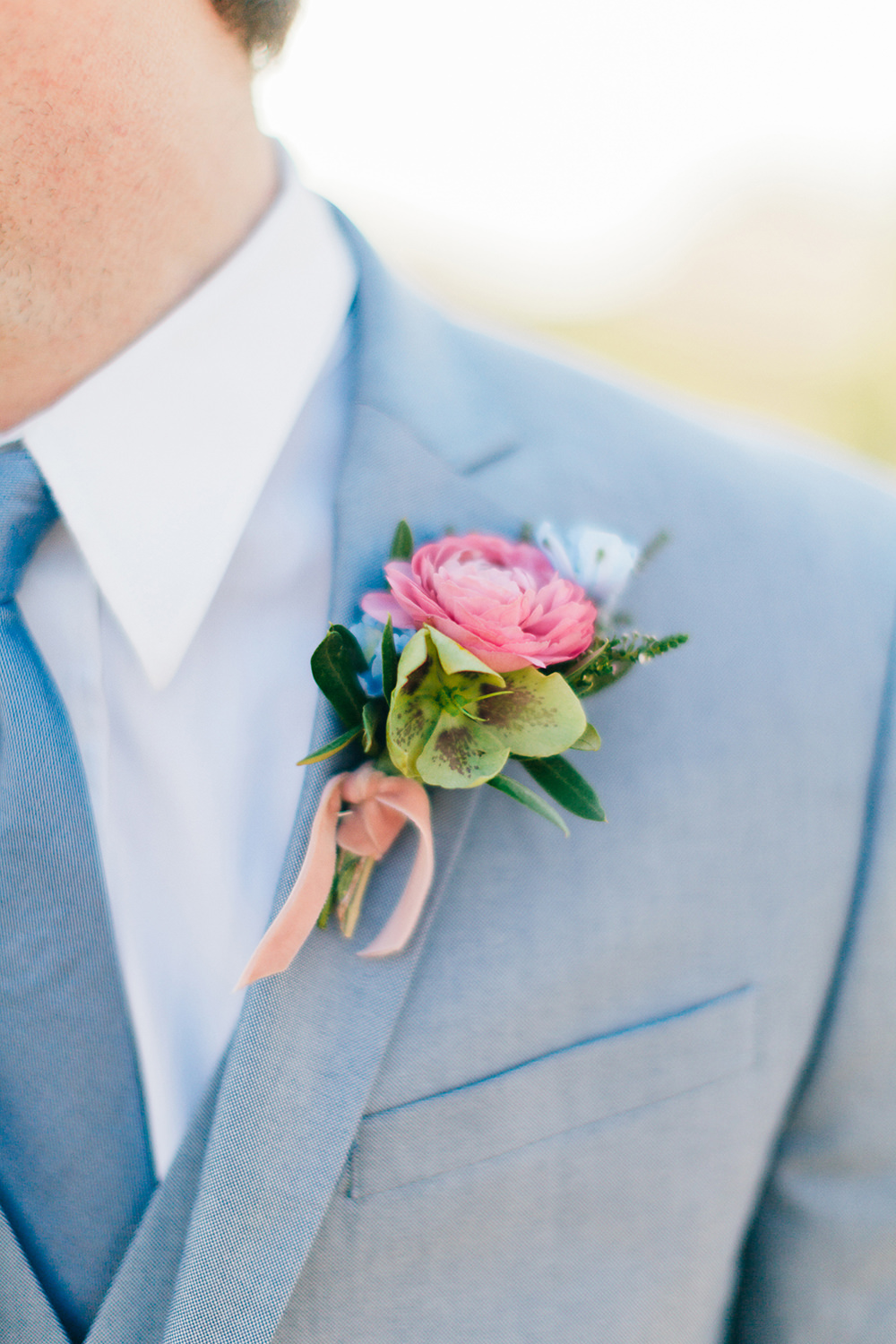 pink boutonnieres - photo by Katie McGihon Photography https://ruffledblog.com/spring-almond-orchard-wedding-inspiration